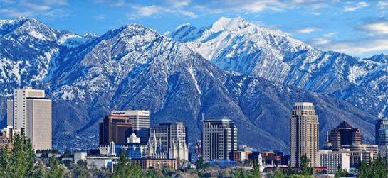 Skyline of downtown Salt Lake City with the Towering Wasatch Mountain range in the background
